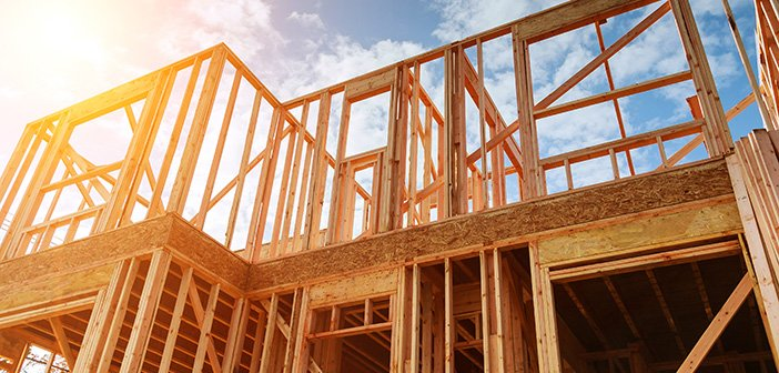 home framing during home construction against cloudy sky