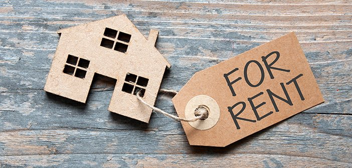 for rent tag and cardboard cutout of house