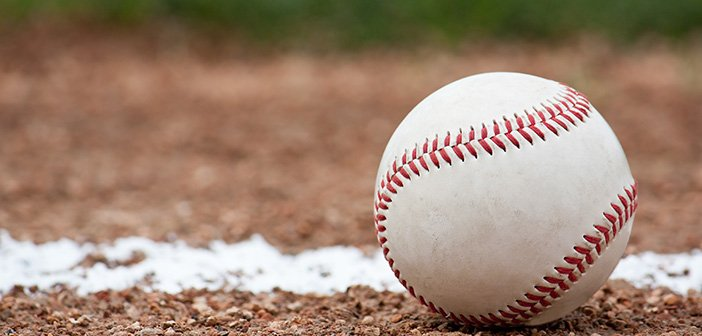 Close-up of a baseball sitting near the foul line