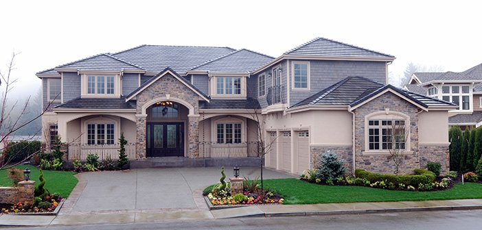 exterior of very large home with well manicured landscaping